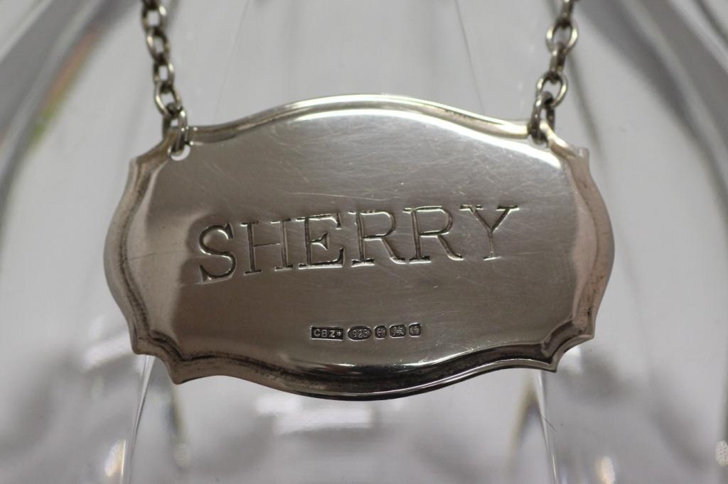 zilveren flessenlabel sherry